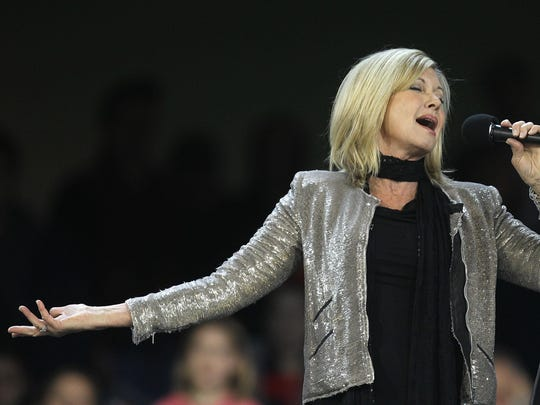 Olivia Newton-John, shown performing in 2011 in Melbourne, Australia.