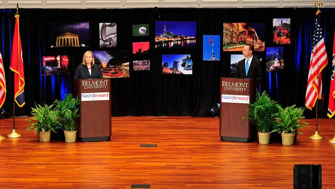 Mayoral candidates Megan Barry and David Fox participate in a debate Wednesday, Aug. 19, 2015, at Belmont University.