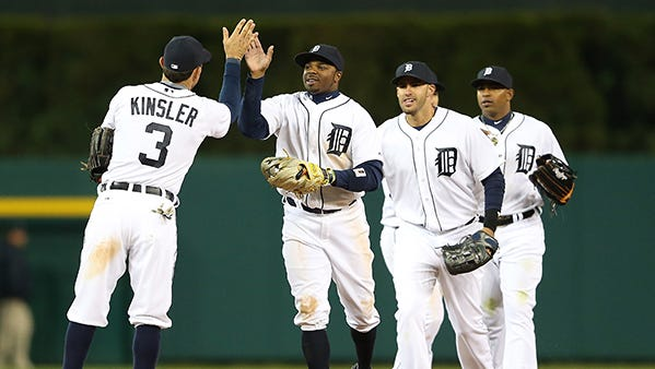The Tigers had high-fives all around in their victory line after defeating the Yankees Monday night.