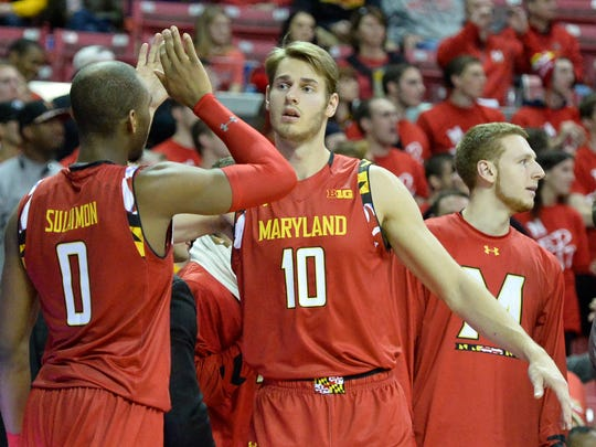 Maryland Terrapins guard Rasheed Sulaimon (0) and Maryland Terrapins forward Jake Layman (10) celebrate after being removed from the game during the second half against the Purdue Boilermakers at Xfinity Center. Maryland Terrapins defeated Purdue Boilermakers 72-61.