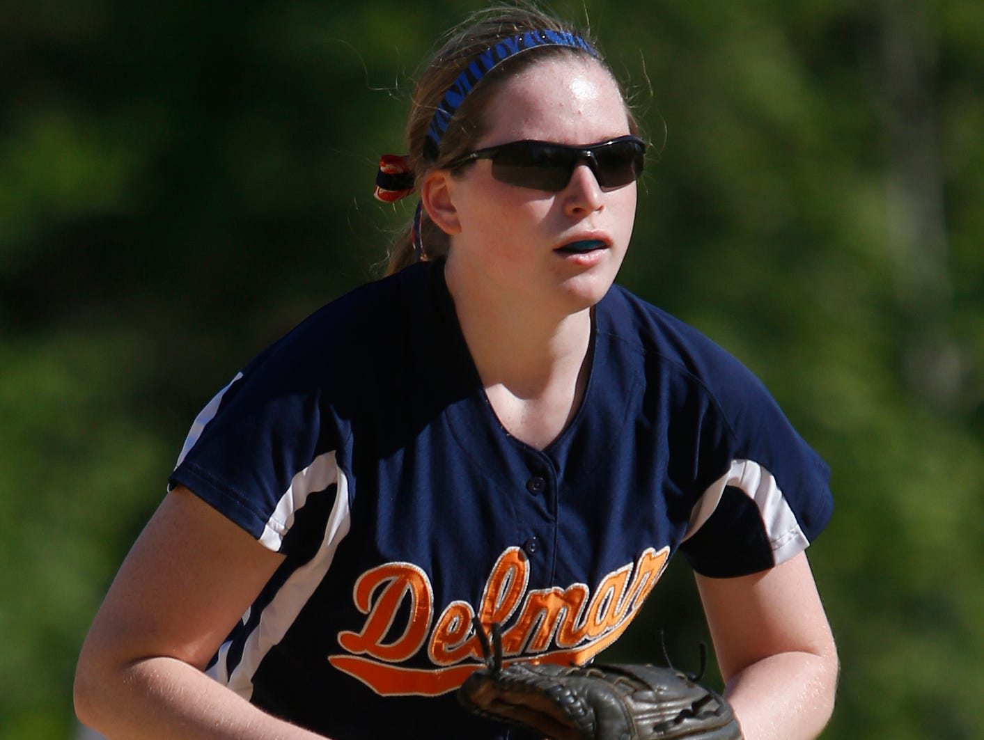 Delmar's Alexis Layton steps into a pitch during her five-inning perfect game, an 11-0 win against Newark Charter on Thursday.