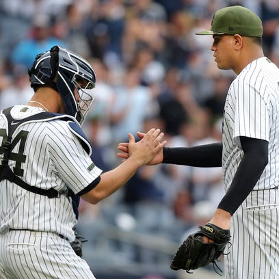 Yankees catcher Gary Sanchez (24) celebrates with relief