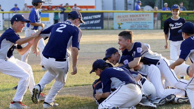 Big Flats players celebrate after winning the District 6 Little League 11-12 championship Tuesday at Elmira Heights Kevin Cicci Little Leaague Field.