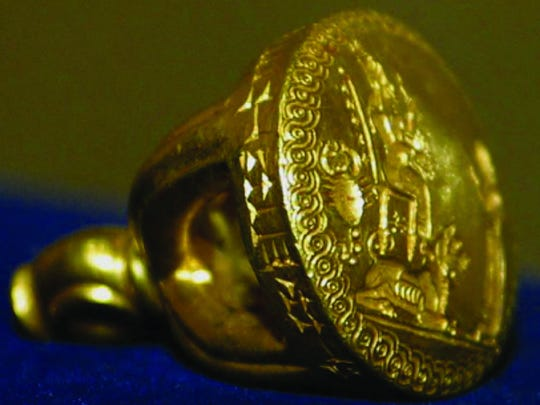 The cuneiform inscription around Hama's seal reads,