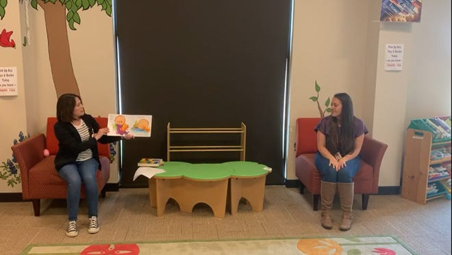 Andrea Tyler, left, and Rainea Urbina are shown in a screenshot from a video leading a recent installment of Baby Storytime at Melissa Public Library. The library, located at Melissa City Hall, reopened its doors to the public earlier this week with limited hours and social distancing requirements in place.