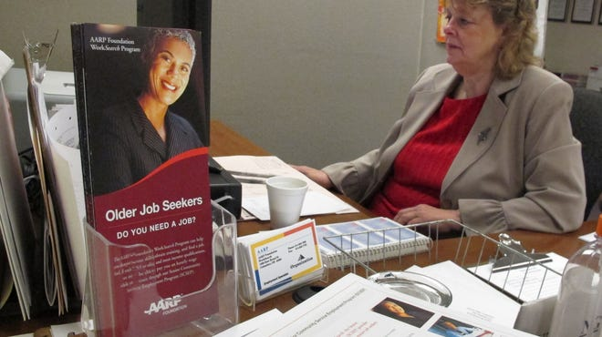Nancy Seagraves, 61, works at her computer at an AARP Foundation office in Columbus, Ohio, through a program that provides financial support and subsidized training for some low-income, older workers while they look for full-time jobs.
