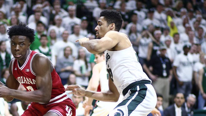 Kenny Goins, right, of the Michigan State Spartans plays defense against Indiana on Feb. 14, 2016, in East Lansing.