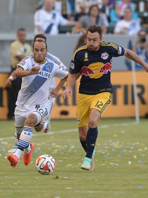 Galaxy midfielder Landon Donovan and  Red Bulls midfielder Eric Alexander chase down the ball.
