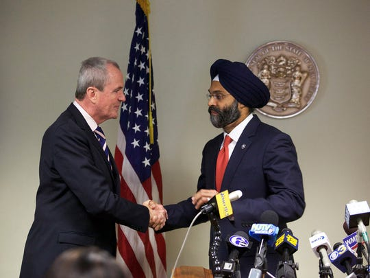 Gov.-elect Phil Murphy, left, introduces his choice for attorney general, Bergen County Prosecutor Gurbir S. Grewal, in Trenton on Tuesday afternoon.