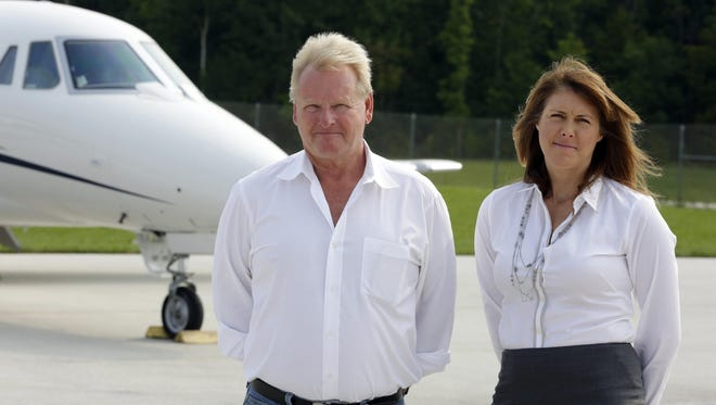 Burrows aviation owner Ron Burrows, left, and his business manager, Mindy Smith, pose by an airplane Monday, Aug. 31, at Memorial Airport in Sheboygan Falls.