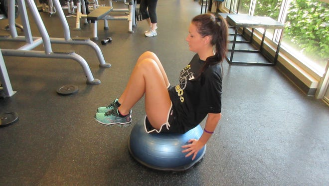 Sit on a Bosu and place your hands to balance either on the back of the Bosu or on the floor behind you.