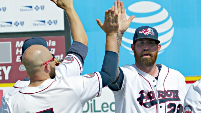 Somerset Patriots teammates of Shaun Garceau (left) and Jon Hunton celebrate a first-half win.  The Somerset Patriots have teamed up with the Pride Center of New Jersey to hold the first-ever Pride Night at TD Ballpark on Sept. 5.