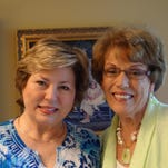P.E.O. Chapter AE's newest member Annetta Hill is welcomed by Lois Hoover.