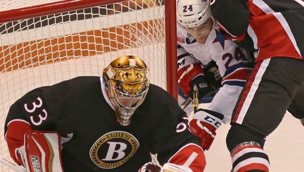 Rochester's Allan McPherson can't reach a loose rebound
