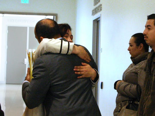Maria Alcantar hugs Deputy District Attorney Jimmy