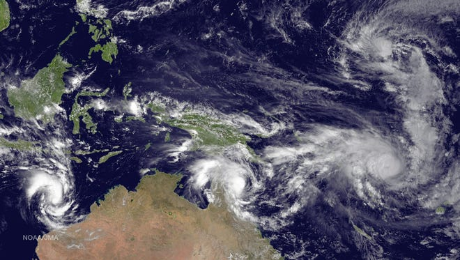 From left to right: Tropical Cyclone Olwyn in the Indian Ocean heading south for landfall near Learmonth on the west coast of Australia, Tropical Cyclone Nathan meanders northeast of Cooktown, Queensland, Australia in the Coral Sea, Tropical Cyclone Pam tracks due south heading for the islands of Vanuatu in the southern Pacific Ocean and Tropical Depression 3 heads west-northwest towards Guam in the northern Pacific Ocean.