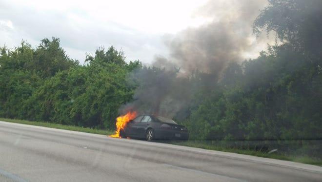 Car on fire near Pineda Causeway