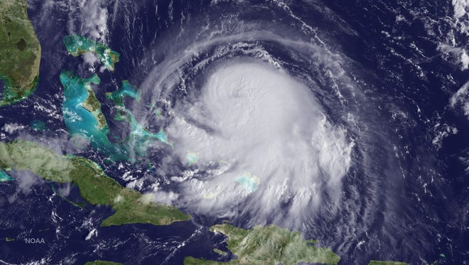 A handout picture made available by the National Oceanic and Atmospheric Administration on Oct. 1, shows a satellite image of Hurricane Joaquin in the Atlantic Ocean.