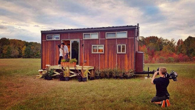 A photo taken during the filming of 'Tiny House Nation' of Vincent Sorgentoni and Sam Adams in front of their tiny house.