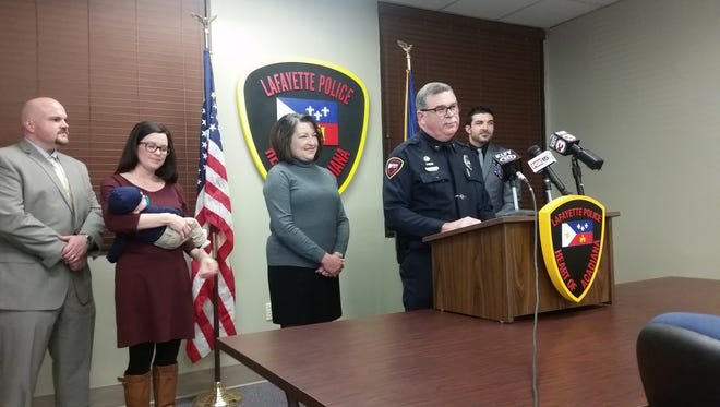 Lafayette Police Chief Jim Craft announces his retirement surrounded by his family Friday morning.