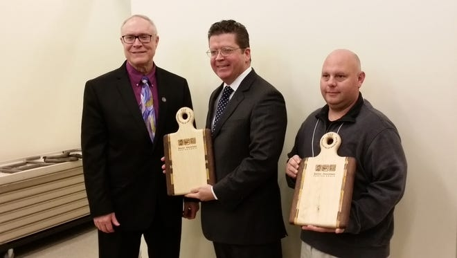 Franklin County Commissioners Bob Thomas and David Keller and Greene Township Supervisor Shawn Corwell are pictured with their Spirit of South Mountain Awards.
