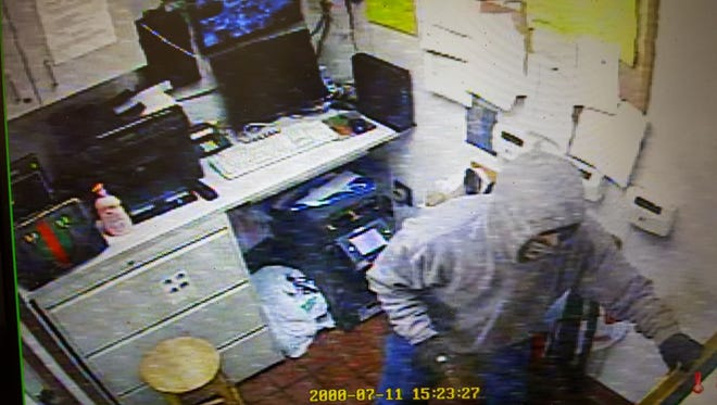 A robbery suspect at the Tilghman Road McDonald's is captured here on surveillance video.