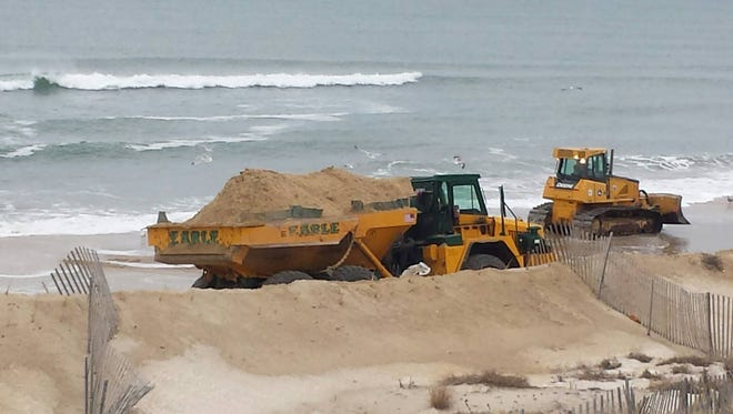 Crews from Toms River's contractor, Earle Asphalt, dump sand on beahces in Ortley Beach in late January.