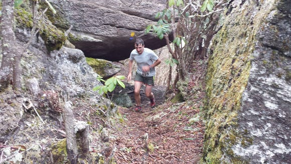 A runner heads down from the Blackrock summit during the Assault on Blackrock Trail Race on March 19 in Sylva.
