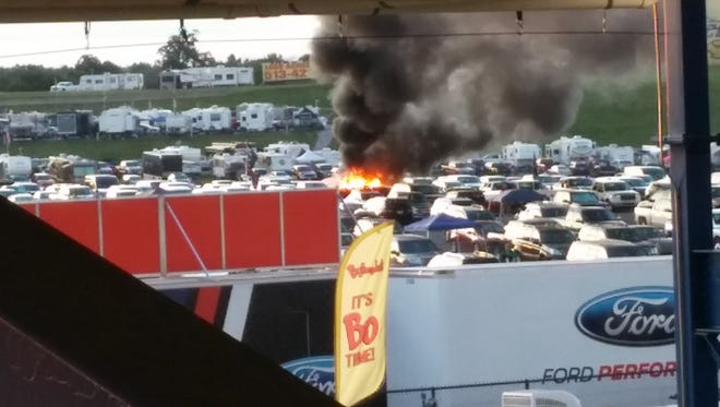 A truck fire gives off smoke in a parking lot at Kentucky Speedway during the Quaker State 400.