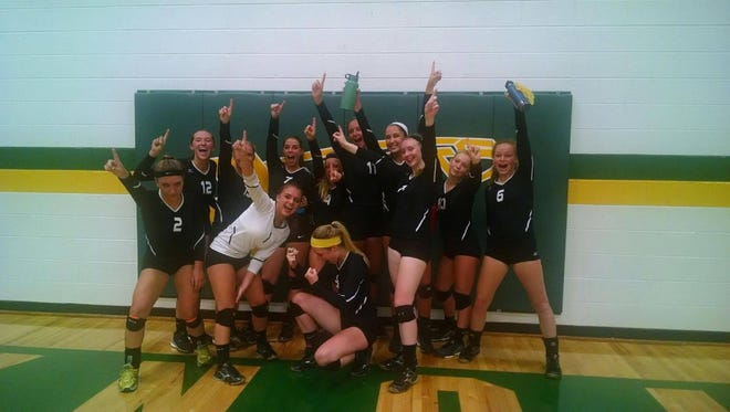 Tuscola volleyball players celebrate after Tuesday night's win at Reynolds.
