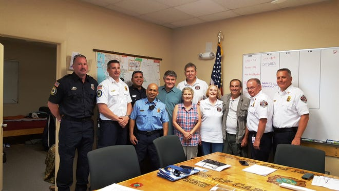 Isles of Capri Advisory Board, along with Greater Naples administrators and fire fighter/rescue personnel pose for what may be the historical final meeting of this committee if the full merger of the two districts occurs on Oct.1. Fron left, back: Ray Kilmer (driver engineer paramedic ), Jeff Davenport (battalion chief), Chris Mercier (firefighter), Ray Kane (Capri Advisory), Dan Herrington (Capri Advisory); Front: Lt. Jorge Lara (firefighter), Jeri Neuhaus (Capri Advisory), Donna Dolan (Capri Advisory chair), Matt Crowder (resident and former Advisory chair), Director Wayne Martin (Greater Naples Fire/Rescue) and Chief Kingman Schuldt (Greater Naples Fire/Rescue).