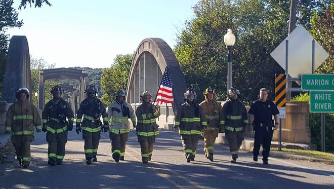 Area fire and police departments recently participated in a 9/11 Remembrance march. In addition to Cotter, other departments participating included Fairview, Flippin and Rea Valley.