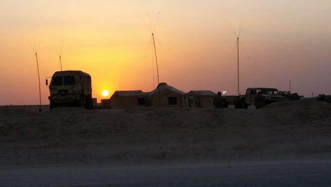 The sun sets over the brigade tactical operations center, or TOC, during the final day of the brigade command post exercise.