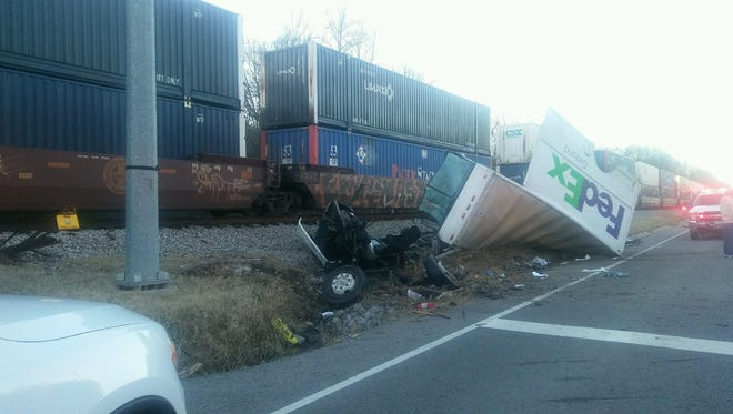 A FedEx delivery truck driver was injured Thursday afternoon after colliding with a train in Williamson County.