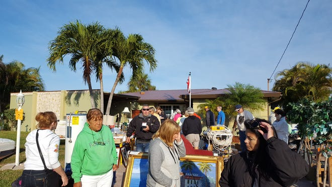 One of the many crowded yards among the 80 plus registered sellers at the Isles of Capri 30th annual All-Island Yard sale on Saturday, Jan. 28.