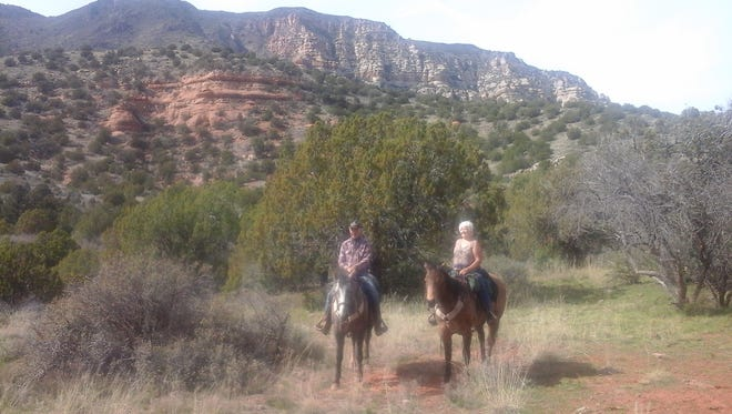 Rodney and Charlene Boom take in the scenery on a trail in the Red Rock area in Arizona.