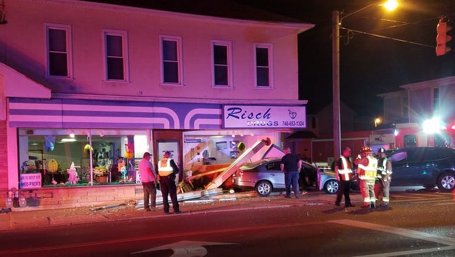 The front of Risch Drugs at 533 North Columbus was damaged in a crash Saturday night.