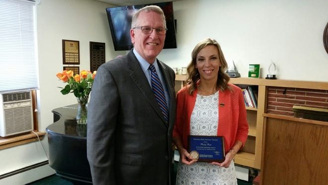 Montana Attorney General Tim Fox presents the 2017 Outstanding Crime Victim Advocate of the Year  to Becky Rate, , emergency shelter coordinator at the YWCA Mercy Home.