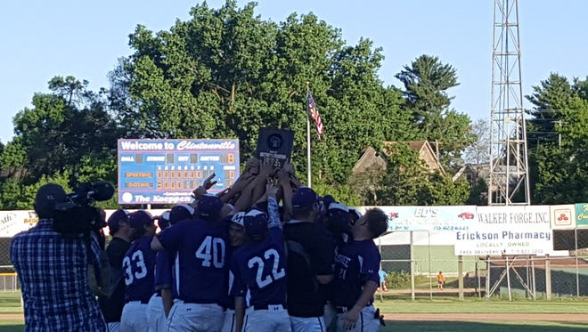 The Mosinee baseball team celebrates a sectional championship in Clintonville.