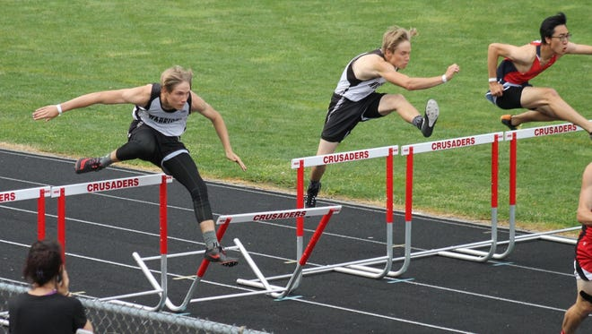 Lutheran Westland's Jake O'Reilly (left) and Dillon O'Reilly compete during the recent MIAC championship meet, which the Warriors won. Lutheran Westland also won the Division 4 regional and had several all-state performers at the June 3 state meet.