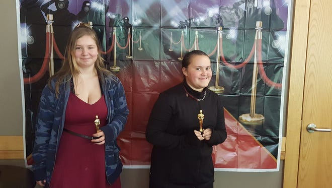 "Parris Cairness and Danita Kilgore accept Oscar-like statuettes for their trailer promoting ""I am Malala."""