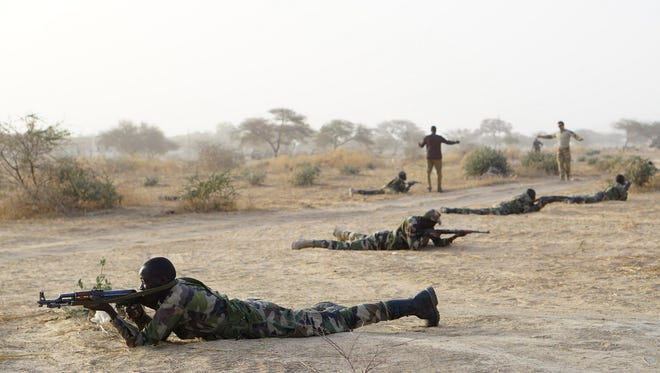 A handout file photo made available by the U.S. Army on Oct. 5, 2017, shows Nigerian servicemembers reacting to contact during Exercise Flintlock 2017 in Diffa, Niger, on March 3, 2017.