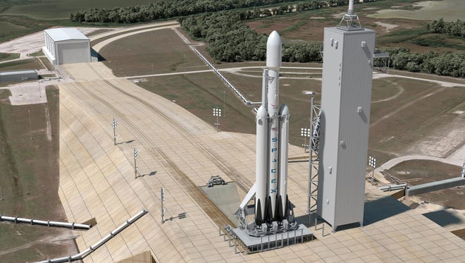 Concept image of a SpaceX Falcon Heavy rocket standing on pad 39A at Kennedy Space Center.