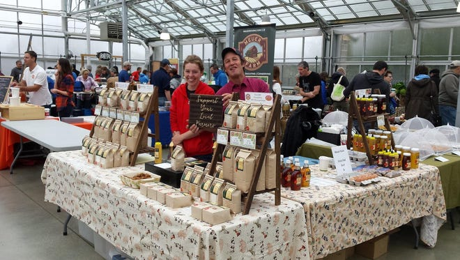 Meuer Farm's Theresa Bock and David Meuer at the Meuer Farm booth at the Milwaukee Winter Farmer's Market.