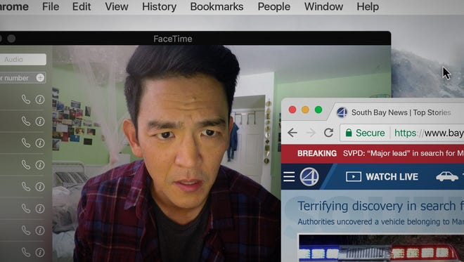 """John Cho plays a father trying to track down his missing daughter by diving into her laptop in """"Searching."""""""