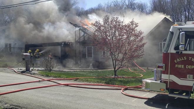 Reporters are on the scene of a house fire in the 2700 block of Kenlo Woods Drive in Frazeysburg.