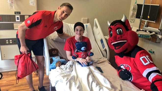 Travis Zajac, at left, and the New Jersey Devils mascot visit Lauren Liff at St. Clare's Hospital in Dover May 4, 2018.
