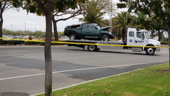 A tow truck removes a pickup involved in a fatal crash early Thursday morning on Rose Avenue in Oxnard.