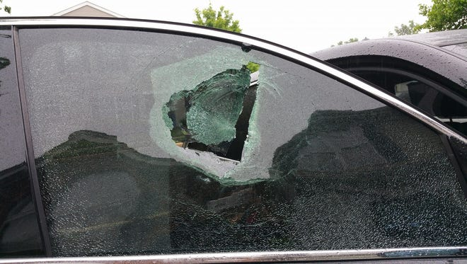 The window damage caused by a rock thrown into a Franklin woman's vehicle.