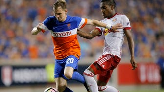 FC Cincinnati midfielder Jimmy McLaughlin (20) goes downfield against Red Bulls defender Michael Murillo (62) in overtime of the Lamar Hunt U.S. Open Cup Semifinal match between FC Cincinnati and the New York Red Bulls at Nippert Stadium in Cincinnati on Tuesday, Aug. 15, 2017. The Red Bulls came from a 2-0 deficit to win 3-2 in overtime.